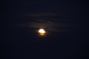 Super Moon coming out of clouds