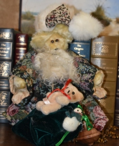 Santa Bear with tapestry cloak, yellow mohair bear, tapestry paws, hat trimmed with rabbit fur. Sale price $45