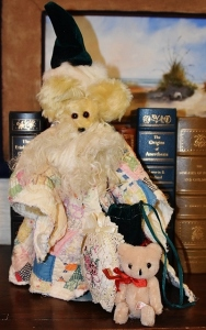 Santa bear with antique quilt cloak, bag of toys, rabbit fur trimmed hat, mohair beard, yellow mohair bear