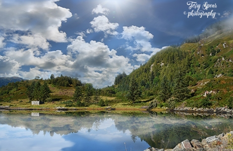 reflections in the glassy loch image of clouds in loch darker 900x600