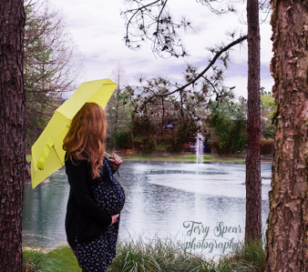 jenn 27 weeks looking at water fountain between two trees 500 229