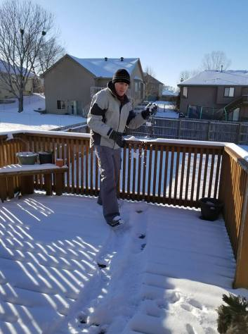 Blaine throwing a snowball at me